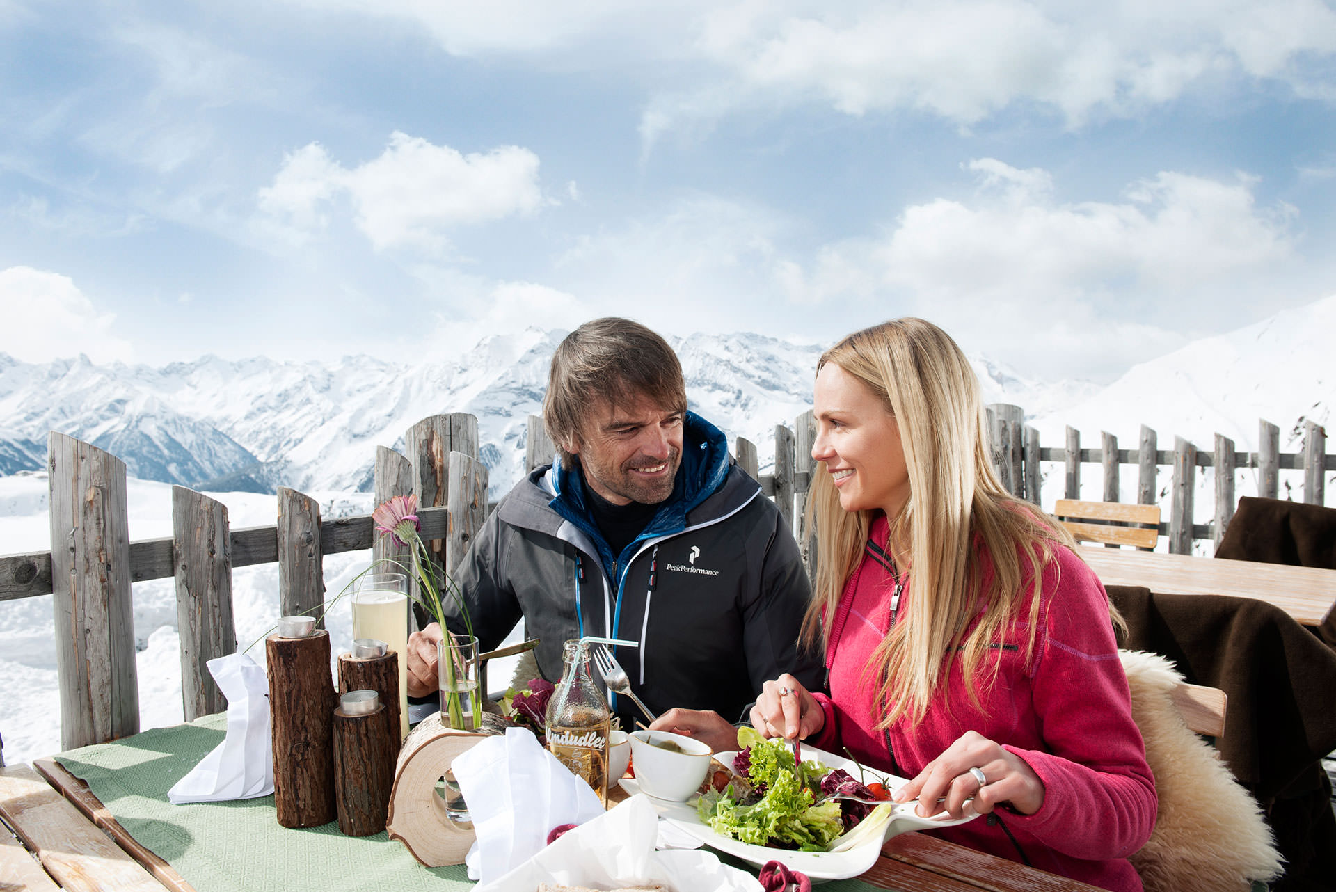 Couple eating on a mountain hut