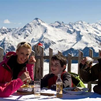 Happy family in the winter on a mountain hut