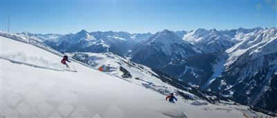 Two skiers on the slope in the Zillertal