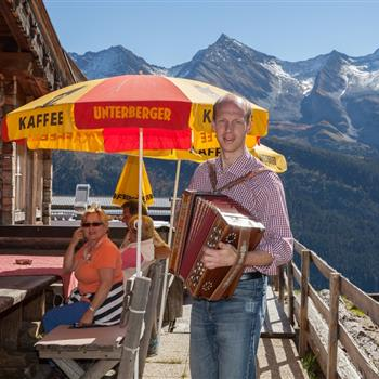 Styrian accordion on an alpine hut with mountain view