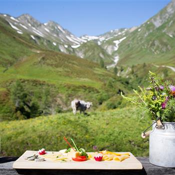 Snack board with bacon and cheese on the alp