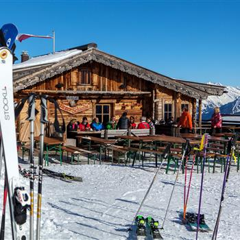 Skiing hut with skiers and guests