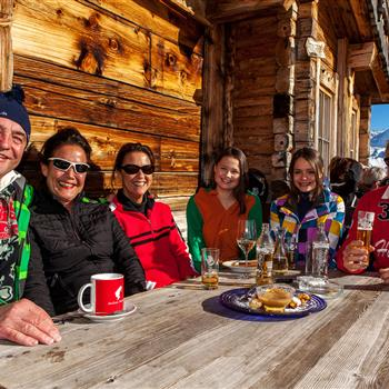 Guests on the alpine terrace at sunshine