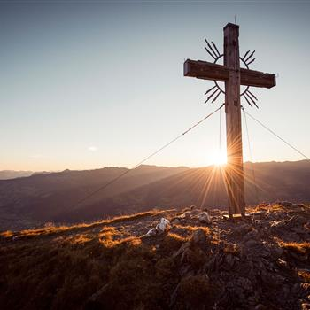 Summit cross at the sunset